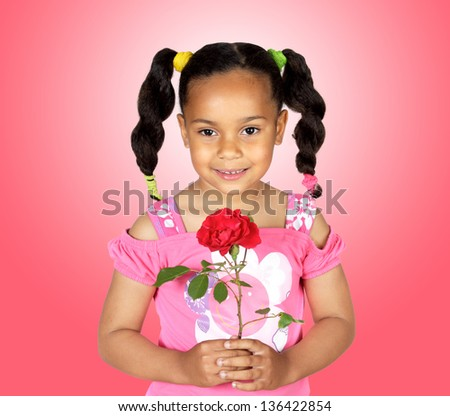 Smiling little girl with a red rose for gift on a over pink background - stock photo