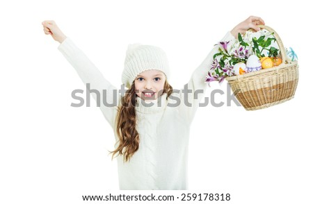 Smiling little girl with basket full of colorful easter eggs and flowers. Easter. Spring. White background.  - stock photo