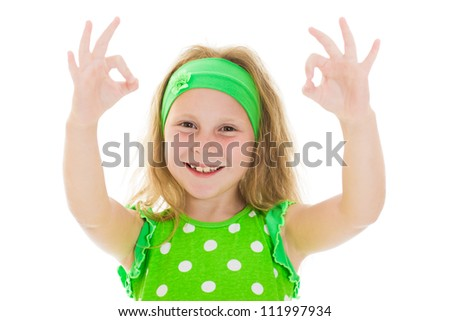 Smiling little girl with thumbs up sign, isolated on white - stock photo