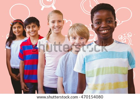 Smiling little school kids in school corridor against pastel pink