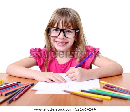 Smiling little schoolgirl with pencils isolated on white.