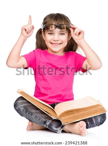 smiling little student girl in eyeglasses with book and finger up. isolated on white background
