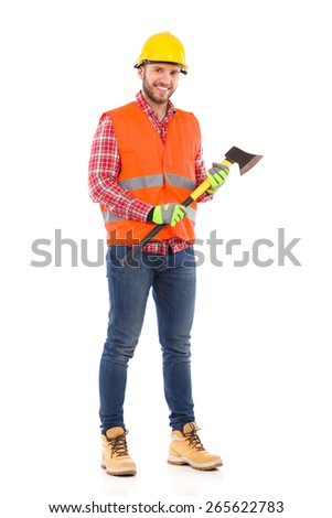 Smiling lumberjack in yellow helmet and orange waistcoat posing with an axe. Full length studio shot isolated on white.
