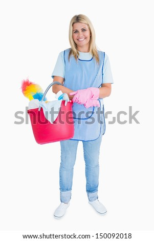Smiling maid holding a pink bucket in the white background - stock photo