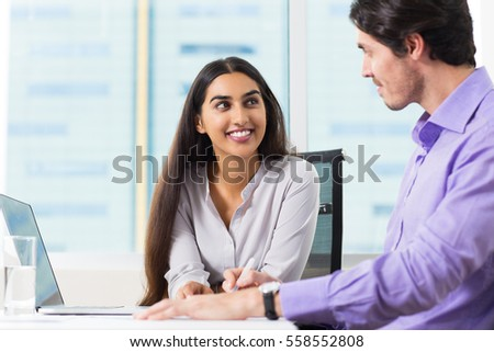 Smiling Male and Female Coworkers Talking at Work