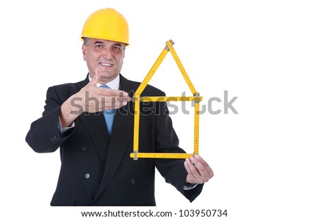 smiling, male architect holding  folding ruler with house shape ,  isolated on white background - stock photo