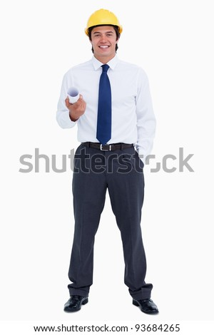 Smiling male architect with plans and helmet against a white background - stock photo
