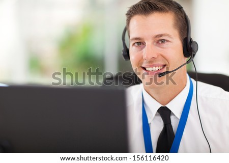 smiling male customer support operator with headset - stock photo
