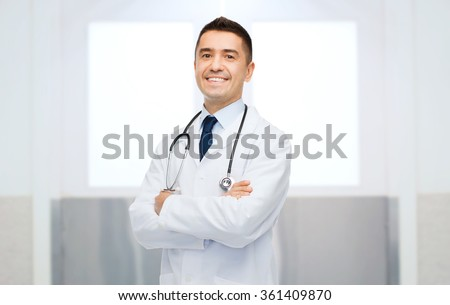 smiling male doctor in white coat - stock photo