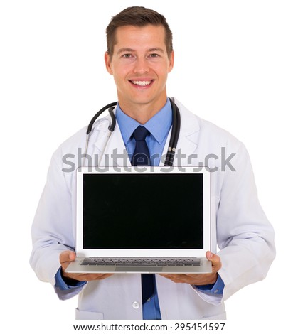smiling male doctor showing laptop screen