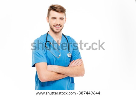 Smiling male doctor standing with arms folded isolated on a white background - stock photo
