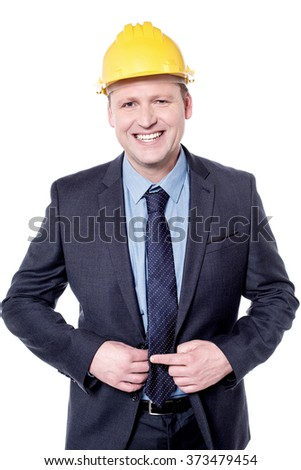 Smiling male engineer posing with yellow hardhat - stock photo