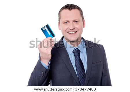Smiling male entrepreneur showing his credit card