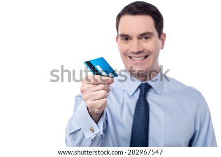 Smiling male executive offering his credit card