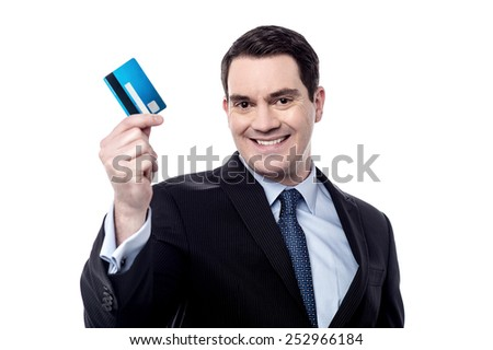 Smiling male executive showing his debit card