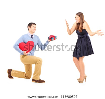 Smiling male giving flowers and excited female isolated on white background