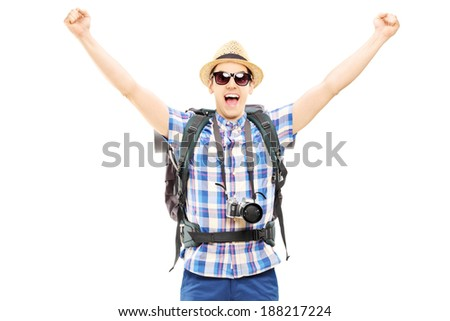 Smiling male hiker with raised hands gesturing happiness isolated on white background