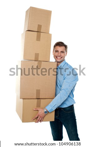 Smiling male holding stack of cartons isolated against white background