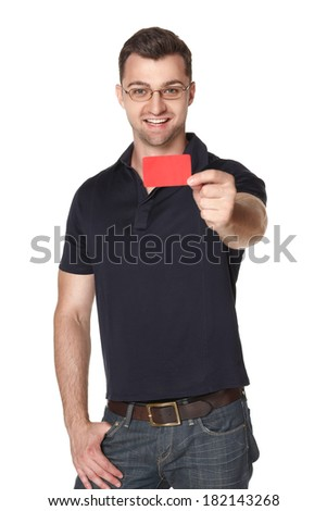 Smiling male in eyeglasses giving you red credit card, over white background - stock photo
