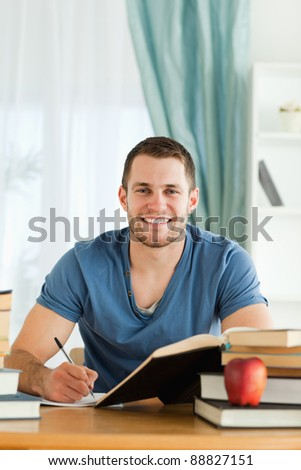Smiling male student happy about his progress