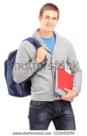Smiling male student holding backpack and books isolated on white background - stock photo