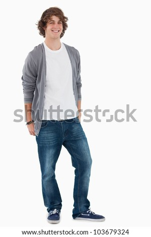 Smiling male student posing hands in the rear pockets against white background