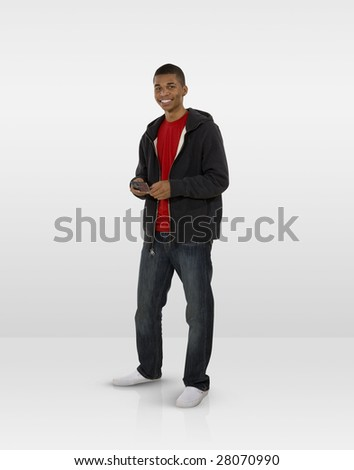 Smiling male teen using mobile phone - stock photo