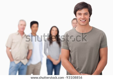 Smiling male with friends behind him against a white background