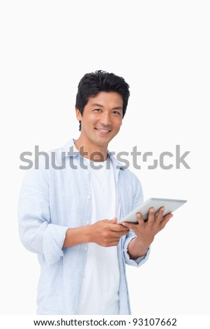 Smiling male with his tablet computer against a white background