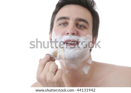 smiling man and brush at face