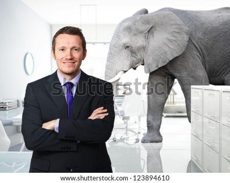 smiling man and elephant in modern �£D office - stock photo