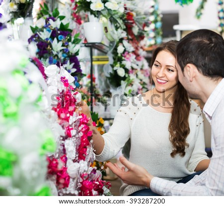Smiling man and woman buying a bouquet at a flower shop