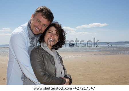 Smiling man and woman, romantic seaside couple