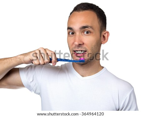 Smiling man, brackets and toothbrush on white background