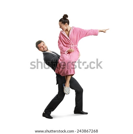 Smiling man carrying a screaming, discontented woman. isolated on white background - stock photo
