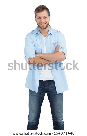 Smiling man crossing arms on white background - stock photo