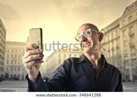 Smiling man doing a selfie - stock photo