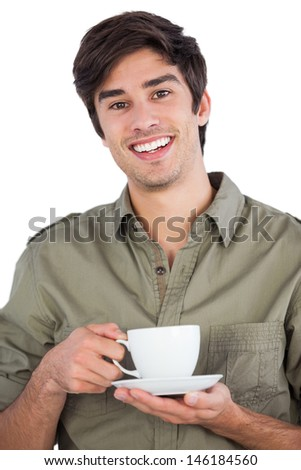 Smiling man holding cup of coffee and looking at the camera - stock photo