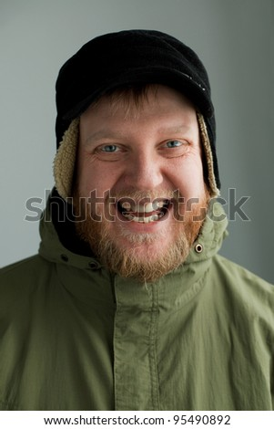 Smiling man in a hat and  light green jacket