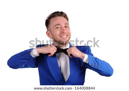 Smiling man in blue suite with on white background