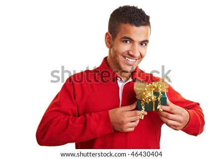 Smiling man in red sweater holding a small gift