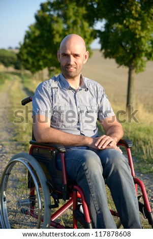 smiling man in wheelchair - stock photo