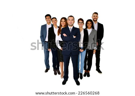 Smiling man leading his happy team over white background - stock photo