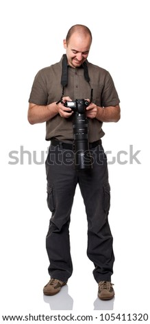 smiling man look his picture on digital camera - stock photo