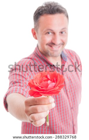 Smiling man offering a red flower to the camera on white background - stock photo