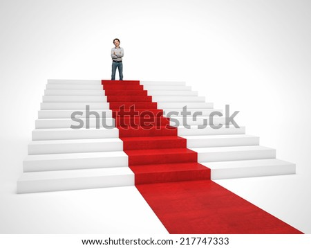smiling man on top of red carpet stair
