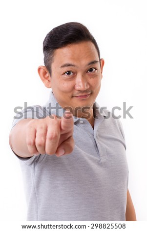 smiling man point his finger at camera - stock photo