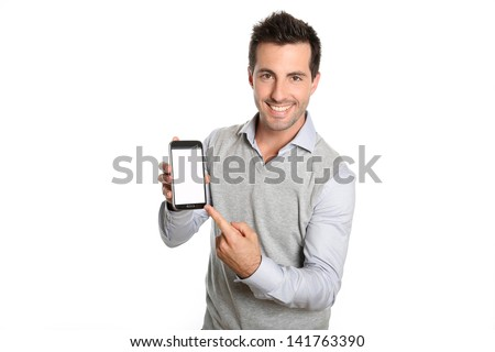 Smiling man pointing at smartphone screen - stock photo