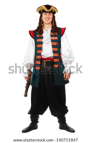 Smiling man posing in pirate costume with a pistol. Isolated on white