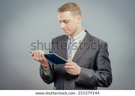 Smiling man reading a book